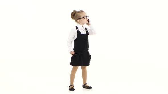 Thumbnail for Little Business Girl Communicates By Mobile Phone on White Background