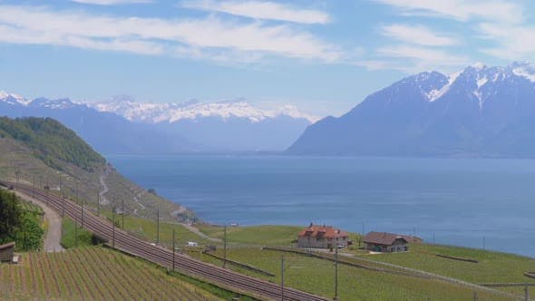 Thumbnail for Landscape View of Railroad Near Lake Geneva with Vineyards and Swiss Alps. Switzerland