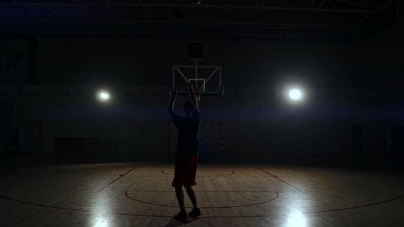 Thumbnail for Behind Shot of Basketball Player Shooting Hoops.
