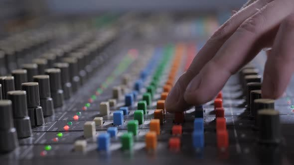 Thumbnail for Record Producer Adjusting Sound on Audio Console