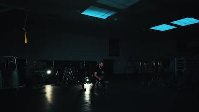 Man Exercising with Heavy Ball in Gym