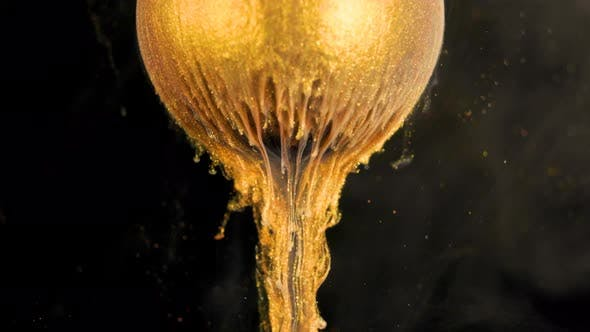 Thumbnail for Golden Shine Paint Slowly Flows From the Ball