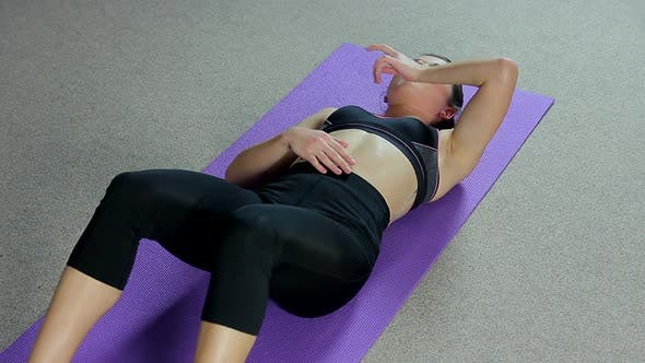 Thumbnail for Tired Female Athlete Lying on Floor in Gym, Woman Exhausted After Active Workout