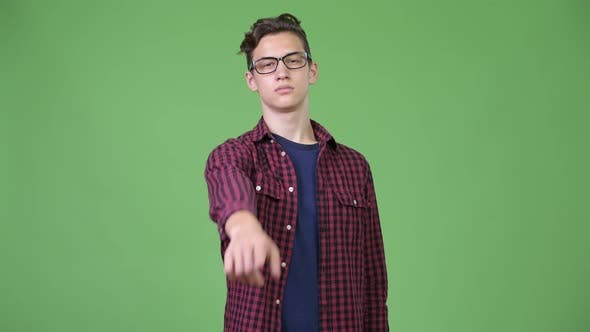 Thumbnail for Young Handsome Teenage Nerd Boy Pointing To Camera
