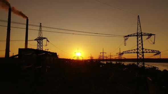 Thumbnail for Transmission lines at sunset.
