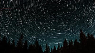 Cometshaped Star Trails in the Night Sky