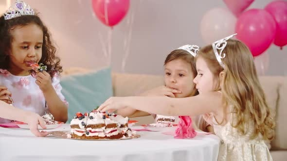 Kids Eating Best Part of Birthday Cake