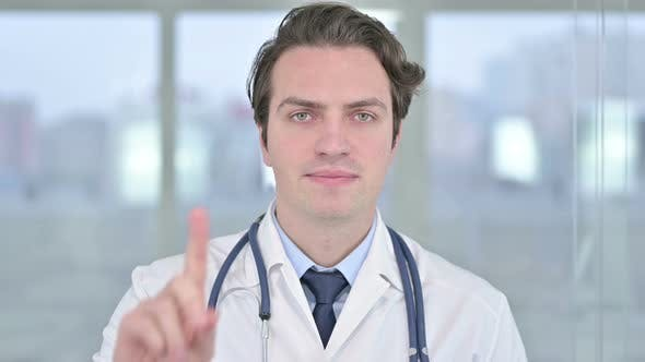 Thumbnail for Portrait of Young Doctor Saying No with Finger Sign