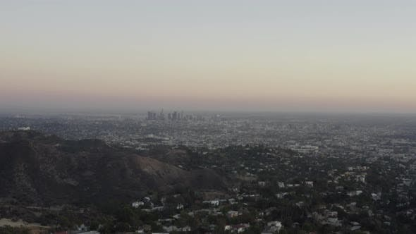 Thumbnail for AERIAL: View Over Los Angeles in Hollywood Hills at Sunset, Los Angeles, California