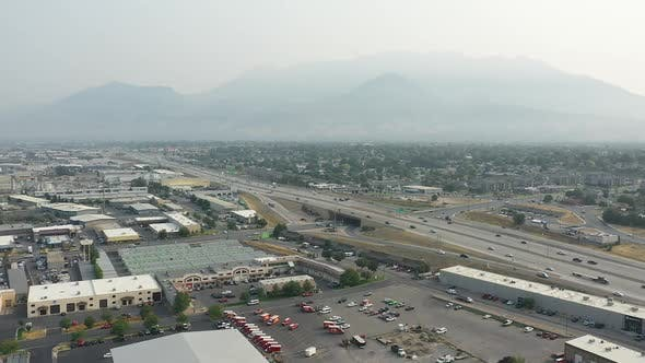 Thumbnail for Aerial view over industrial business area slowly rotating in Utah County