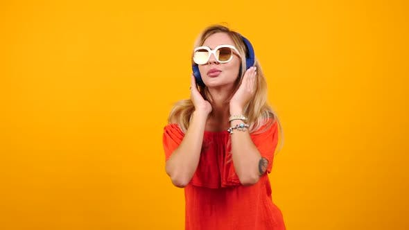 Thumbnail for Gorgeous Happy Woman Wears Sunglasses and Headphones