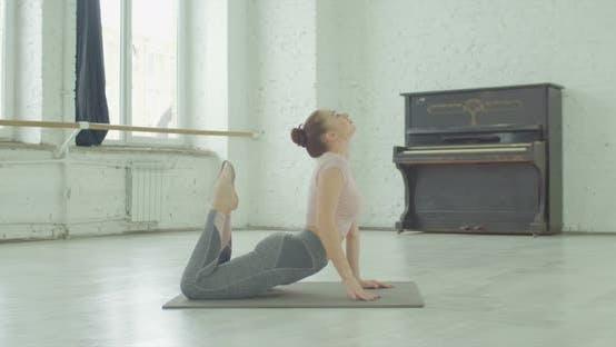 Yogi Fit Woman Doing King Cobra Exercise Indoors