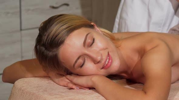 Thumbnail for Female Client Enjoying Relaing Body Massage at Spa Salon 1080p