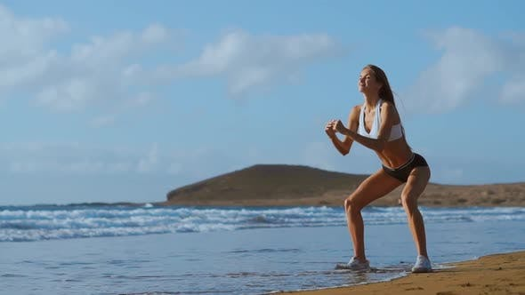 Thumbnail for Sportswoman Wearing Sportswear Doing Squats Exercise Outdoors. Fitness Female Working Out on the