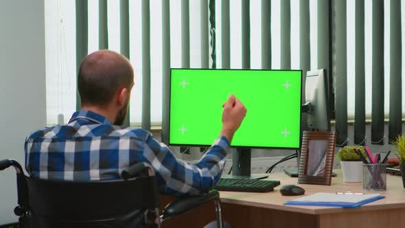 Thumbnail for Businessman in Wheelchair Using Computer with Chroma Key