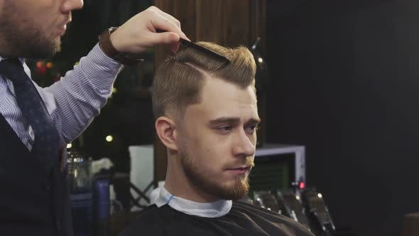 Thumbnail for Professional Barber Using Hairspray and Blow Dryer Styling Hair of a Client