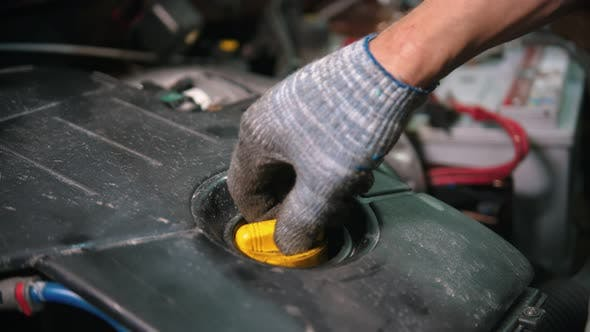 Thumbnail for Auto Repair Shop - Man Worker Checking the Engine Oil Condition