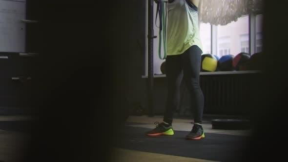 Thumbnail for Female Athlete Swinging Kettlebell