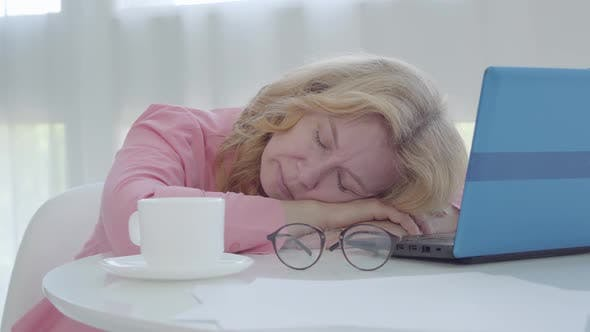 Thumbnail for Exhausted Senior Freelancer Sleeping at the Table. Portrait of Tired Caucasian Businesswoman