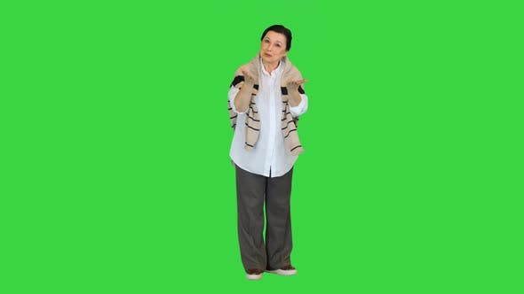 Thumbnail for Middle Aged Woman Talking To Camera on a Green Screen, Chroma Key.