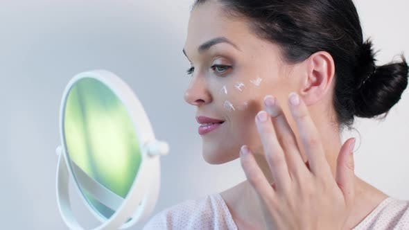 Thumbnail for Woman Applying Cosmetic Cream Treatment on Her Face