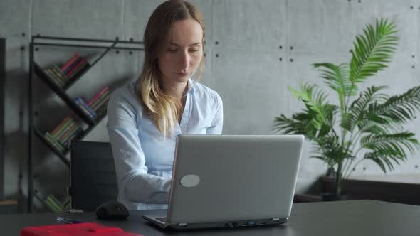Thumbnail for Woman Working Laptop. Business Woman Busy Working on Laptop Computer at Office