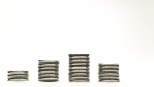 Thumbnail for Silver Coins on Stacks Are Increase and Decrease on White Background Stop Motion Animation