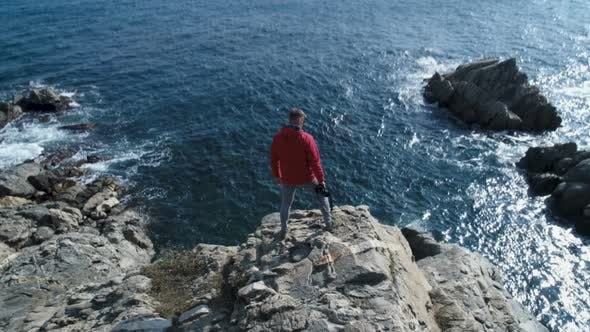 Thumbnail for Adventurous Man Standing On The Edge Of The Cliff
