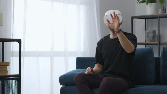 Man is Touching Virtual Display and Wearing Hmd on Eyes Vr Technology for People Home Use of Hitech