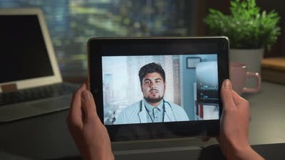 Video Calling with Multiracial Doctor on Tablet