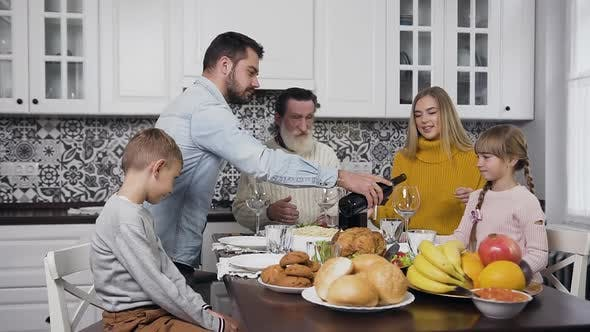 Thumbnail for Happy Family Gethering Together at the Festive Table to Celebrate Thanksgiving Day