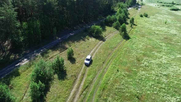 Thumbnail for Copter View Car Driving Through Forest. Riding Car Going Through Fields