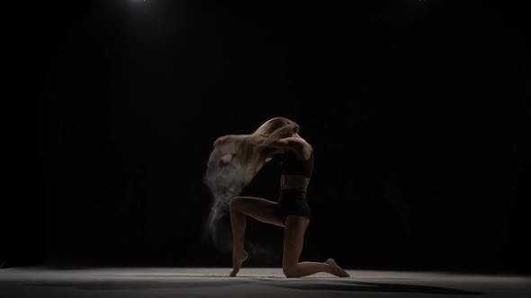 Thumbnail for Sporty Dancer Throwing Dust Particles in Air. Slow Motion