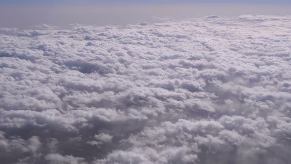 Thumbnail for View of the Curly Clouds From the Window of the Plane