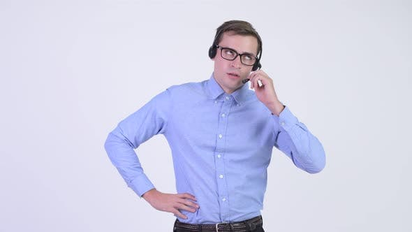 Thumbnail for Young Stressed Businessman As Call Center Representative Looking Annoyed