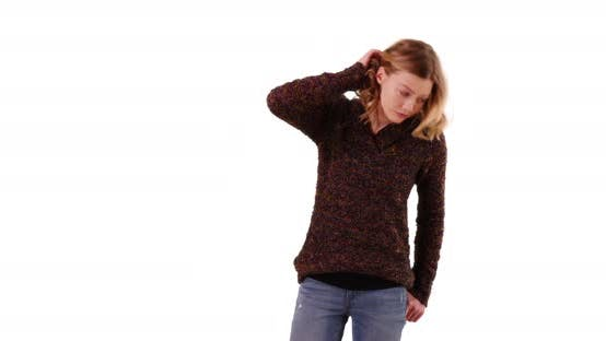 Thumbnail for Smiling female wearing cozy sweater and jeans standing in studio with copyspace