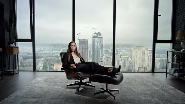 Thumbnail for Businesswoman Sitting on Chair in Office. Entrepreneur Relaxing on Office Chair