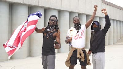 Group of Protesting Young African American People with American Flag on Street.