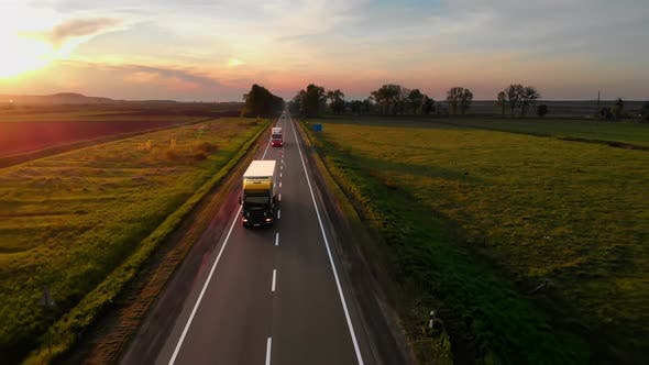 Amazing Aerial Drone View Semi Trucks Delivering Goods By Road