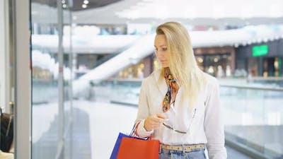 Stylish Woman Looking at Shop Window
