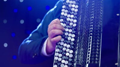 A Man Emotionally Plays Accordion Closeup of Instrument and Hand