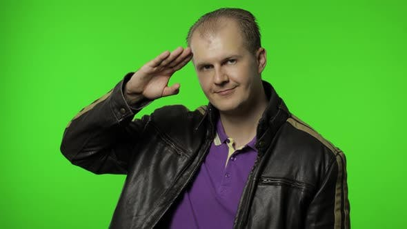 Rocker Man Saluting with Hand and Pretending To Listen Order. Guy Biker on Chroma Key Background