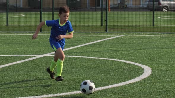 Thumbnail for Young Soccer Forward Taking Pass and Scoring Goal