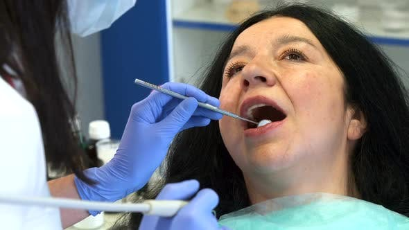 Thumbnail for Dental Hygienist Provides Root Planing for Patient
