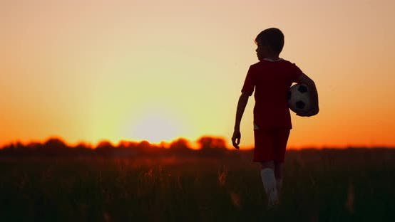 Thumbnail for Tracking a Boy with a Soccer Ball Goes Into the Field and Watches the Sunrise