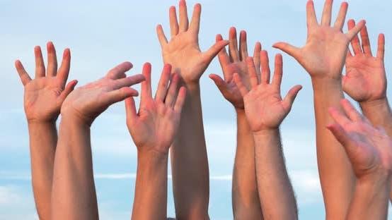 People Raising Hands Up