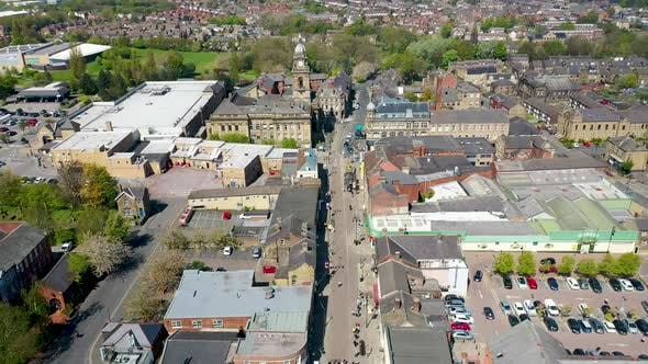 Aerial footage of the village of Morley in Leeds UK, showing an aerial view of the main street