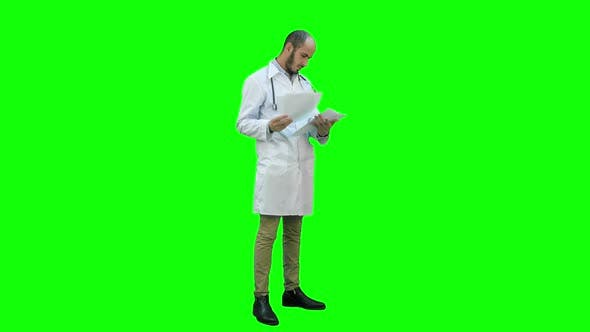 Thumbnail for Male Doctor Checking Medical Documents on a Green Screen, Chroma Key