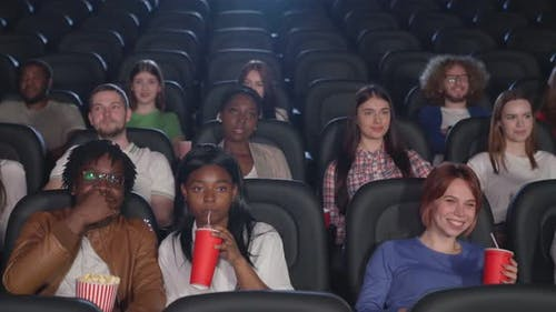 Multiracial Audience Watching Comedy in Cinema.