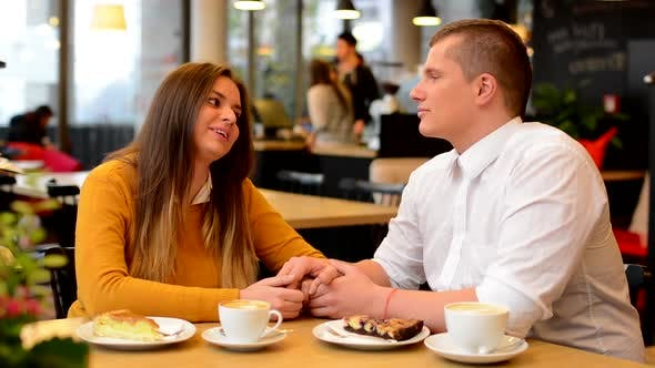 Thumbnail for Happy Couple in Love Kiss in Cafe, Couple Holding Hands, Coffee and Cake